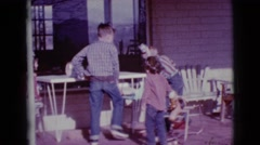 1968: three kids playing on the veranda with headlights CLARKSDALE, ARIZONA Stock Footage