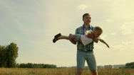 Excited father rotates his little happy son in his arms Stock Footage