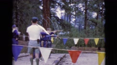 1968: teachers show a group of kids how to use bow and arrow CLARKSDALE, ARIZONA Stock Footage