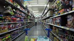 Shopping woman in kids toy and games department POV Stock Footage