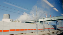 Traveling by train, view from the window of industrial facilities Stock Footage