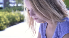 Teen girl texting on phone outdoors 4k Stock Footage