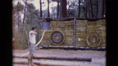 1968: a young male archer making practice on a close range court CLARKSDALE Stock Footage