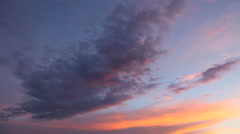 Time lapse clip of fluffy clouds over sunset sky. Beautiful cloudscape Stock Footage