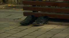 Forgotten shoes, men's and women's pair of shoes, wearing shoes Stock Footage