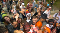 Zombie Walk Festival, zombie pull their hands Stock Footage