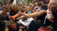 Zombie crowd stretched their arms forward, Halloween Stock Footage
