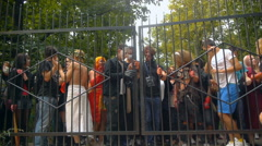 Zombie crowd opens the iron gate, zombies Festival, Halloween Stock Footage