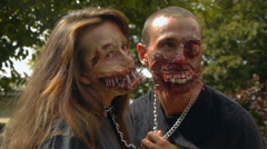 A pair of lovers zombies chained to each other, halloween Stock Footage