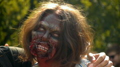 Zombie girl with disfigured face and white pupils, close-up, halloween Stock Footage