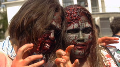 Two girls posing for photos zombies, halloween, zombie festival Stock Footage