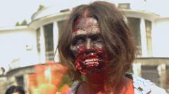 Zombie girl waving hello, close-up, halloween, zombie festival Stock Footage