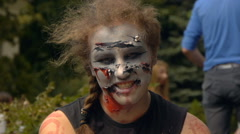 Girl dressed as a zombie growls and smiles to someone, Halloween Stock Footage