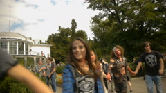Halloween participants dance in a circle, mass celebrations Stock Footage