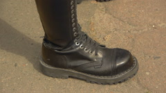 Man in combat boots with sharp weapons recedes Stock Footage