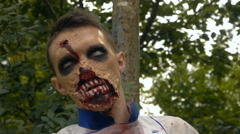 Young guy zombie, halloween, zombies react to sound, close-up Stock Footage