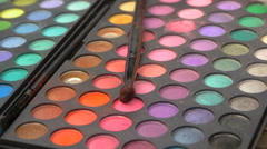 Eyeshadow Palette for makeup and brush, close-up Stock Footage