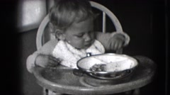 1942: young child sitting in high chair throwing playing with food NEW YORK Stock Footage