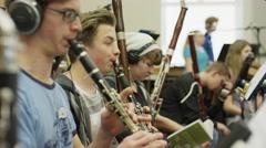 Medium shot of teenage boys in orchestra practice / American Fork, Utah, United Stock Footage