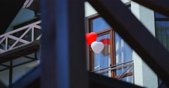 Love heart balloons on house backgrond Stock Footage
