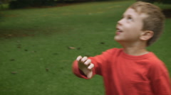A young boy plays with his mother hitting a balloon back and forth - slowmo Stock Footage