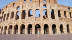 Adorable little active girl having fun in front of Colosseum in Rome, Italy. Kid Stock Footage