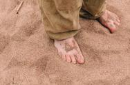 Barefoot male legs on sand Stock Photos