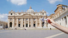 Closeup toy airplane on Colosseum background. Italian european vacation in Rome Stock Footage