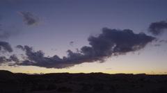 Wide shot of clouds flying over desert landscape / Moab, Utah, United States Stock Footage