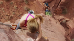 Medium high angle shot of climber fastening rope to carabiner / Fisher Towers, Stock Footage