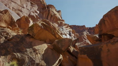 Wide low angle shot of rock formation landscape / Moab, Utah, United States Stock Footage