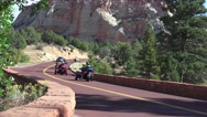 Trike Motorcycle club, Zion National Park, driving away Stock Footage
