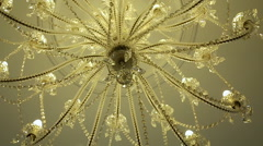 Chandelier of glass or crystal hanging inside Stock Footage