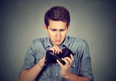 Man with no money. Businessman holding empty wallet Stock Photos