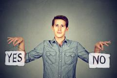 Man with yes no signs Stock Photos