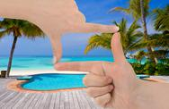 Frame made of hands and beach landscape Stock Photos