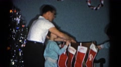1962: mom with her kids busy with arranging tree for xmas CATSKILL, NEW YORK Stock Footage