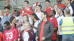 4K Excited sports crowd with British flag clapping & cheering on their team Stock Footage