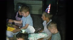 1962: children at a birthday party watching a little boy open gifts CATSKILL Stock Footage