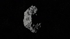 Asteroid flies in space Stock Footage