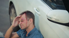 Man had a car accident. head smashed. pedestrian injured in road accidents Stock Footage
