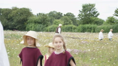 4K Children & adults in costume re-enacting old fashioned farming methods Stock Footage