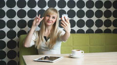 Young girl 20s making selfie photo on smartphone Stock Footage