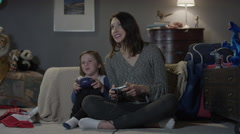 Wide shot of mother and son playing video game / Cedar Hills, Utah, United Stock Footage