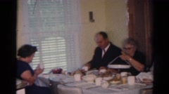 1964: adults and children eating plenty and cheerful around two separate tables Stock Footage
