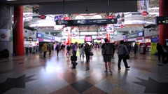 Walking in the Kuala Lumpur Sentral railway station with a lot of passengers Stock Footage