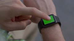 Close up shot of male hands working with smartwatch modern gadget Stock Footage