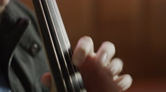 Close up shot of top hand playing cello in bar / Salt Lake City, Utah, United Stock Footage
