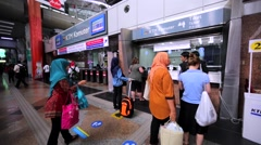 Passengers buy train tickets in the Kuala Lumpur Sentral railway station Stock Footage