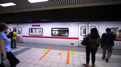 Sentral railway station in KL: entering the train driving to the Batu Caves Stock Footage